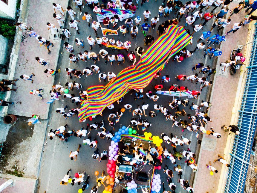 Aerial shot of pride flag during march