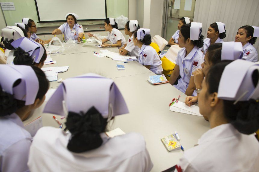 A team of nurses discuss their daily schedule and duties