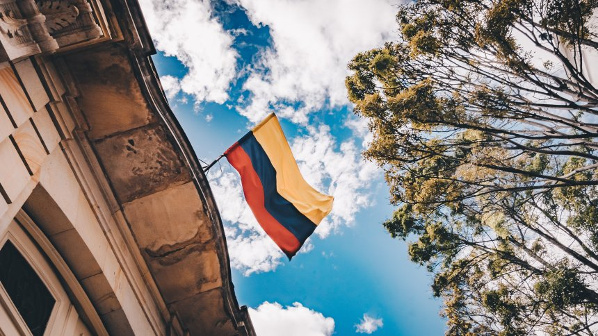 Colombia flag on a public building with blue sky