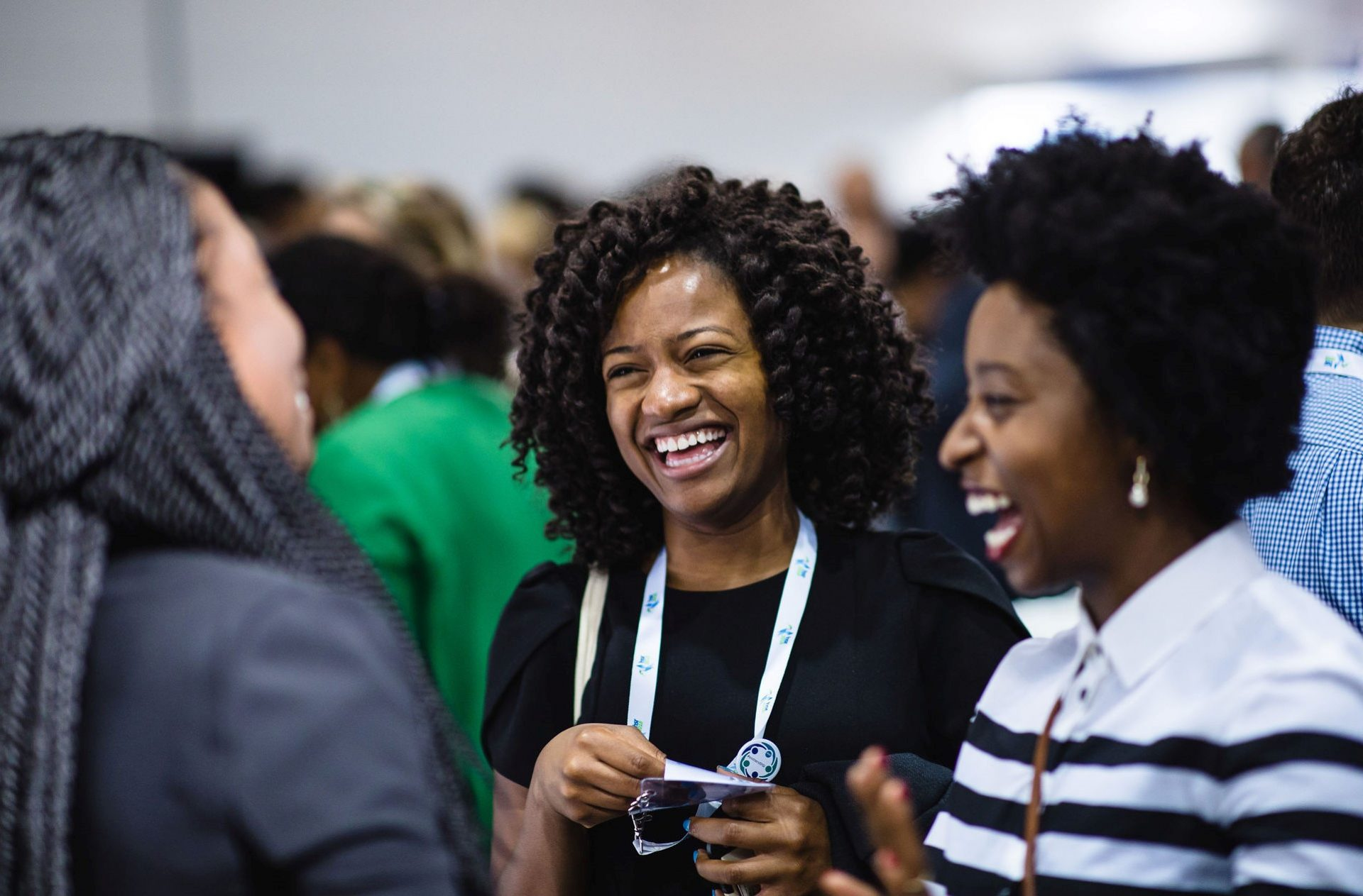 Three women talking and laughing at HSR2018