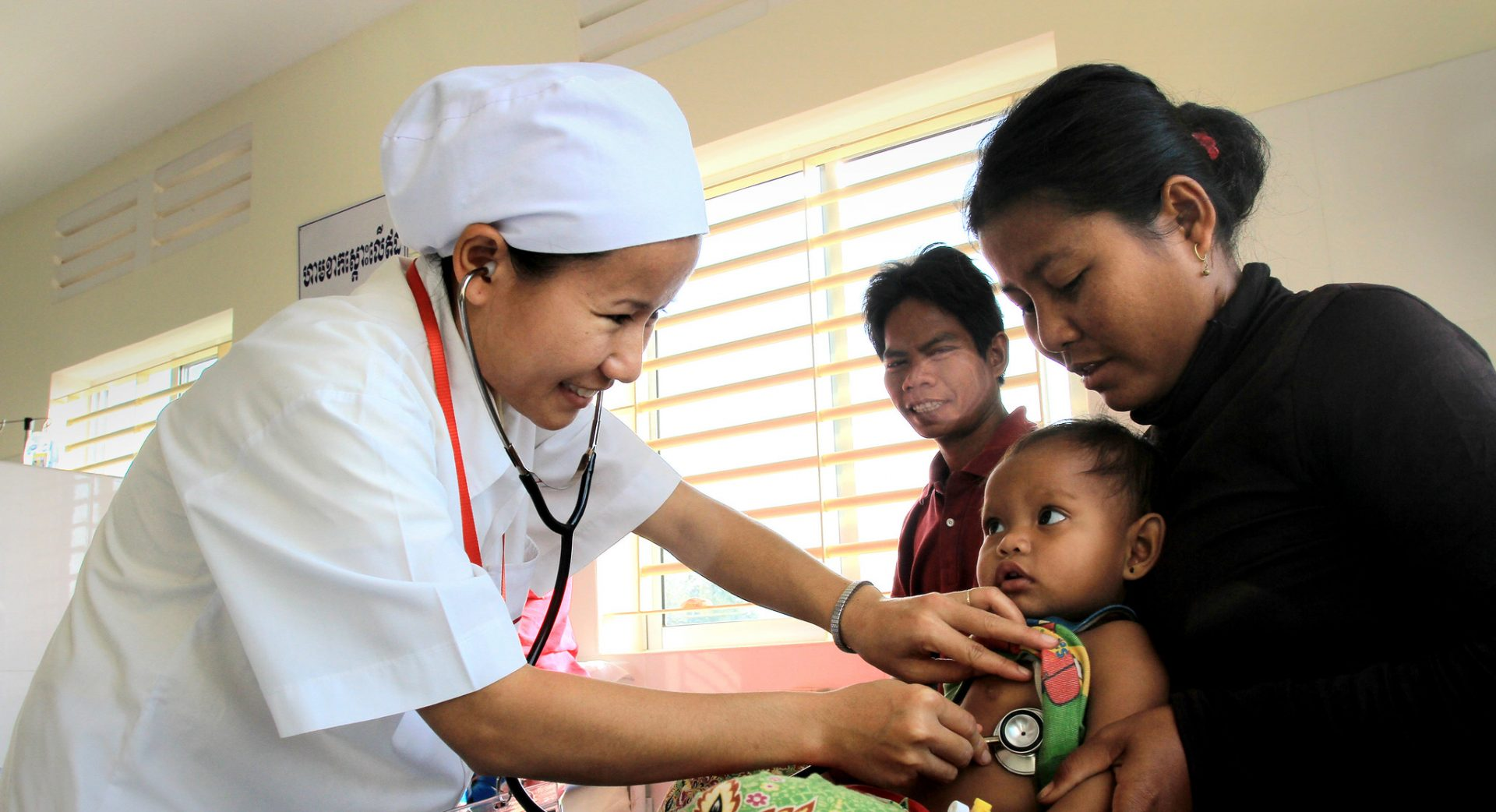 A trained medical staff listens to the hearbeat of an infant at 16 Makara hopsital in Preah Vihear, Cambodia.