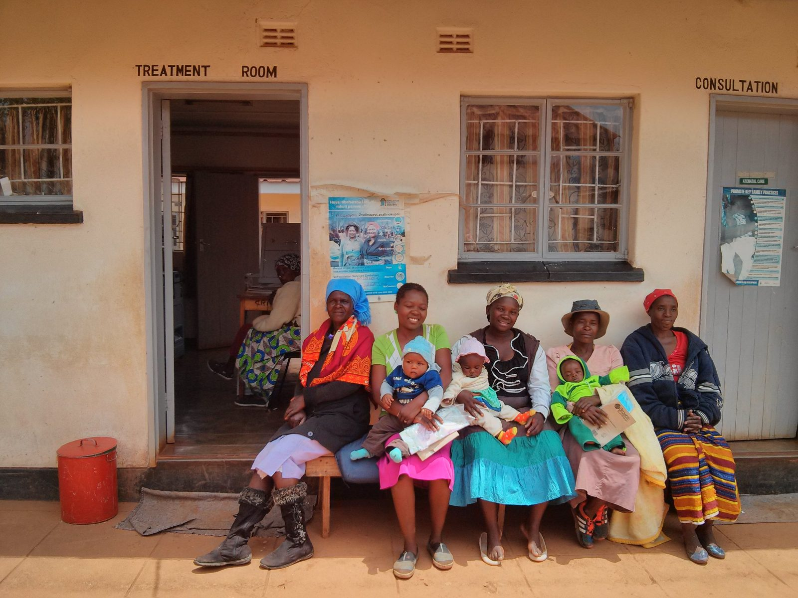 Women sitting in front of the Manicaland health centre