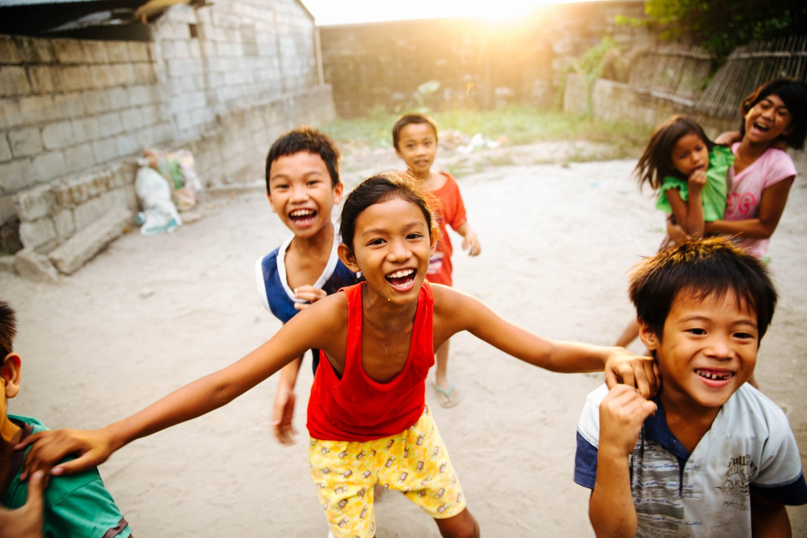 Children laughing and running in the Philippines