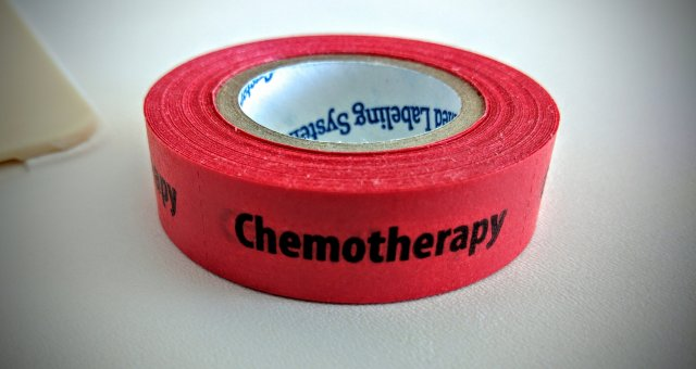 Roll of red tape that says chemotherapy