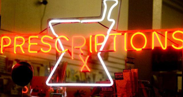 Neon prescriptions sign in pharmacy window