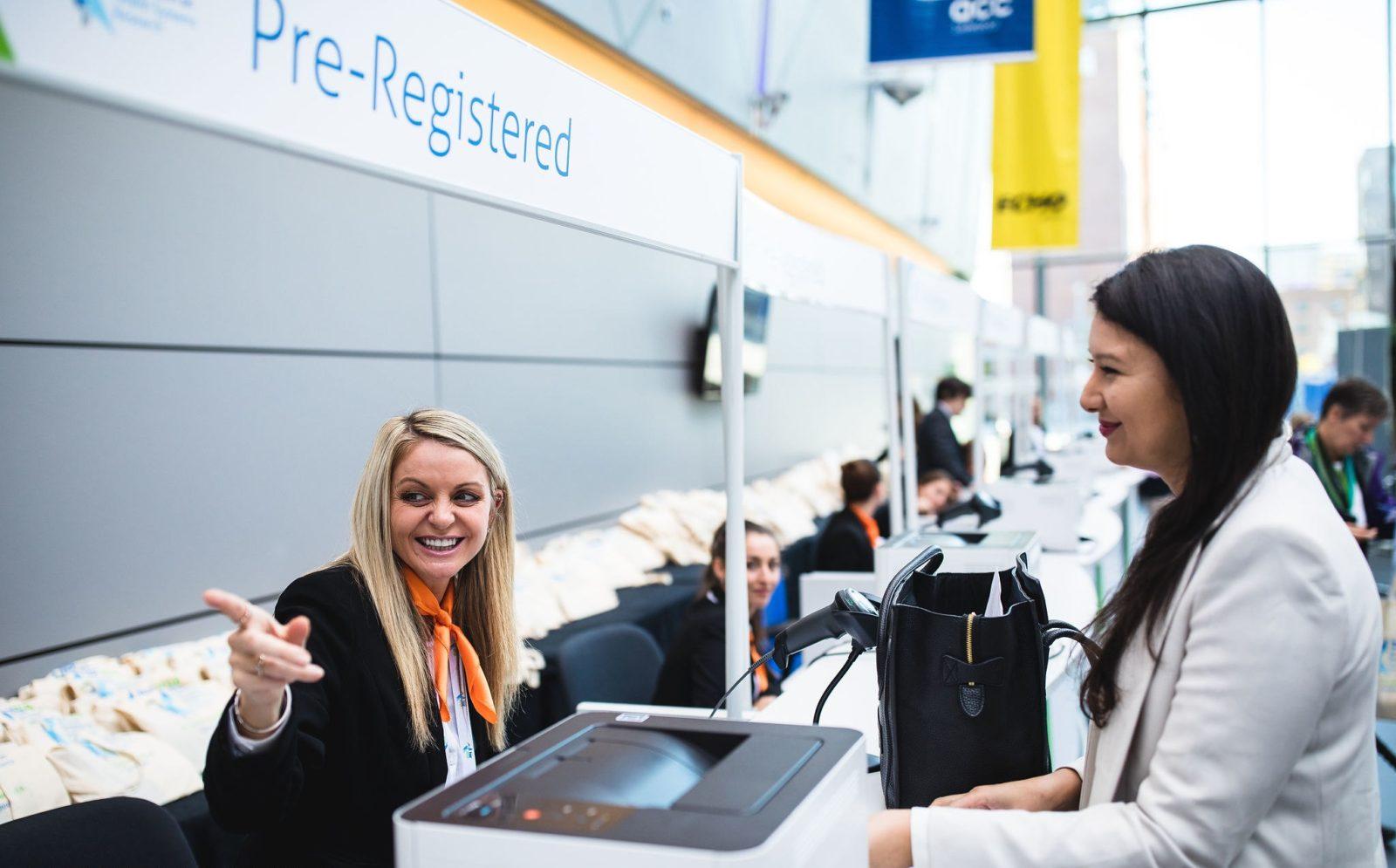 Woman registering at HSR2018 registration desk