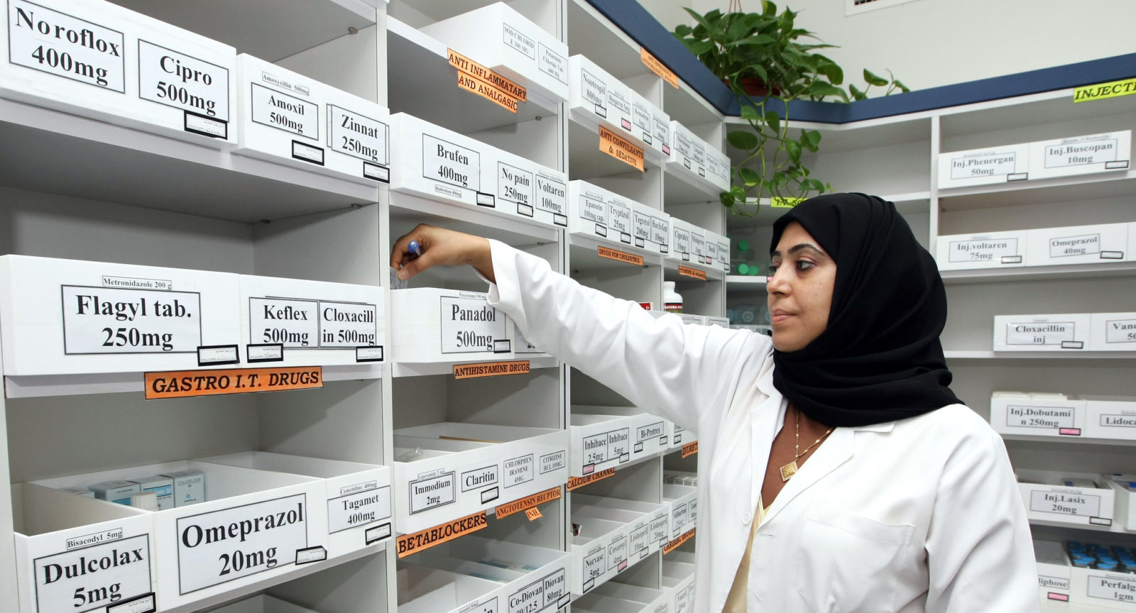 A nurse selects a medicine in a private clinic