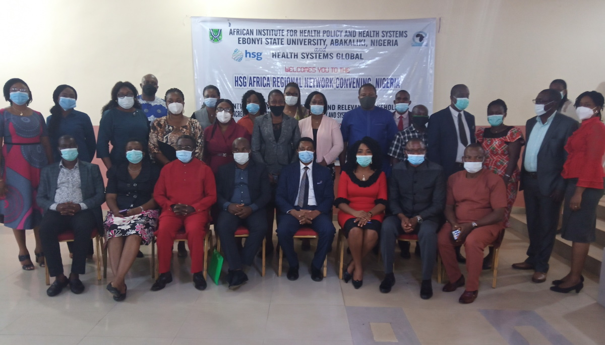 Participants standing in front of a banner at the Nigeria Africa Regional Network convening