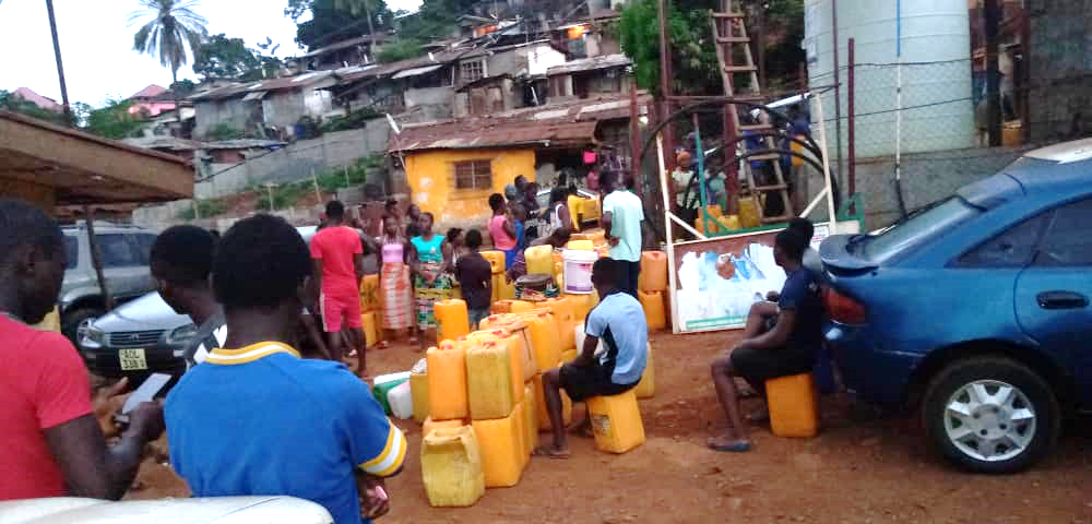 Residents of Dwarzark queueing up for water during lockdown