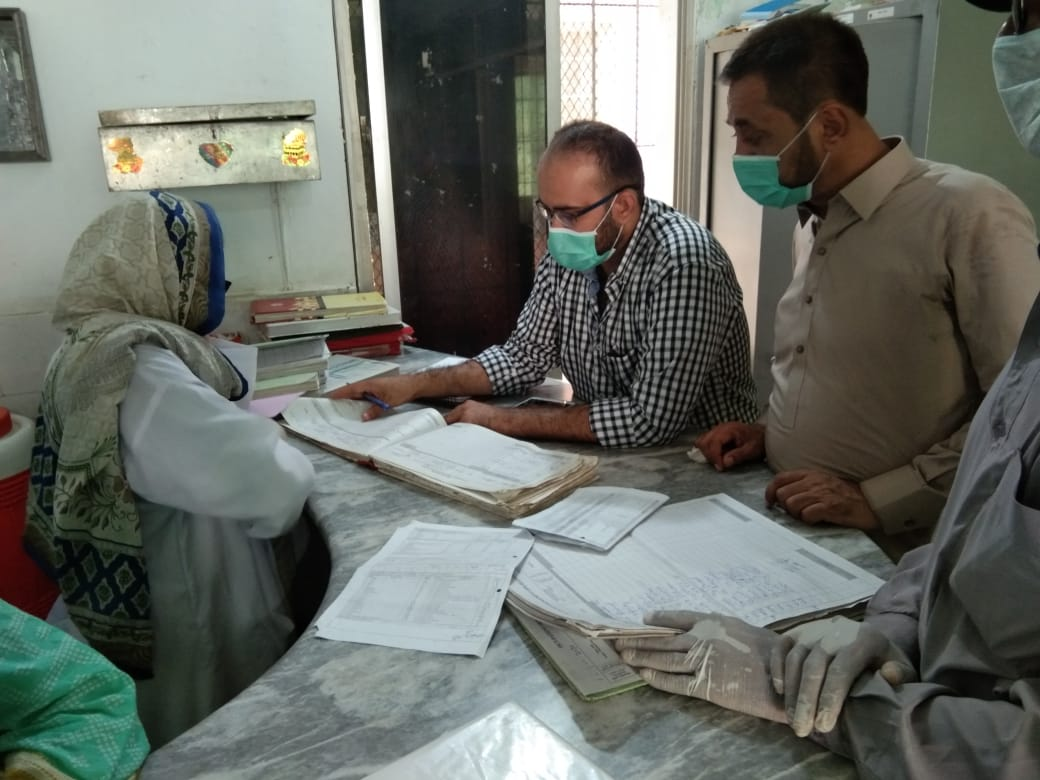 Doctors and a patient at a primary healthcare facility in Sindh province, Pakistan