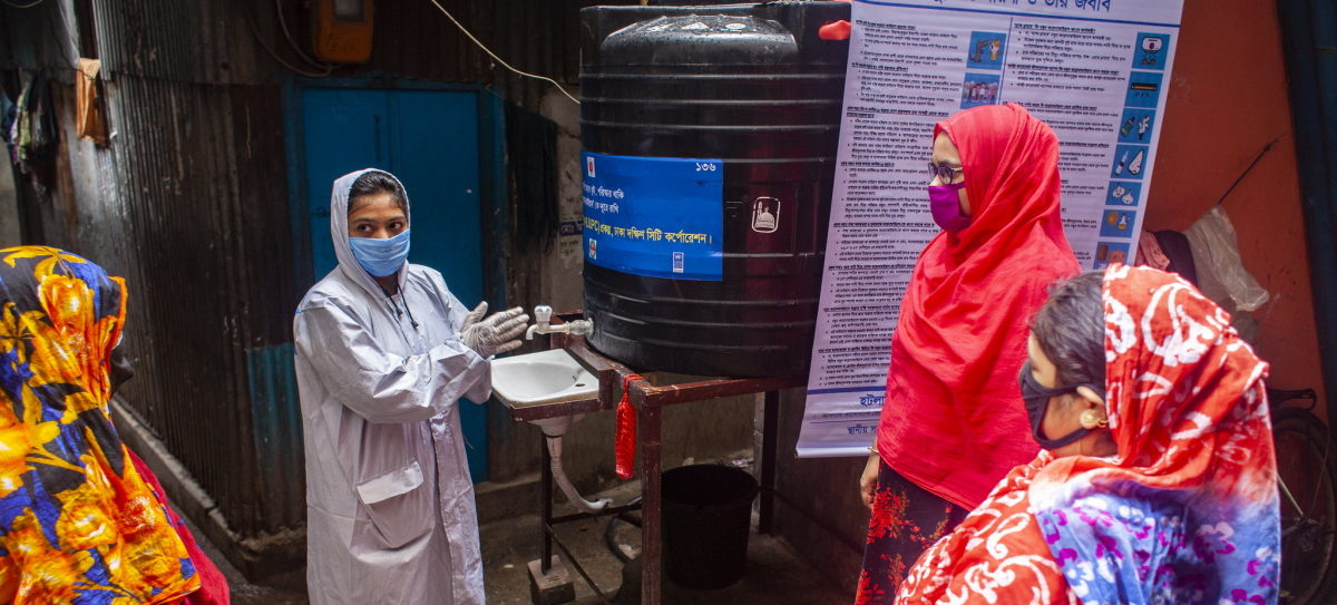 A socioeconomic nutrition facilitator from UNDP Bangladesh shows marginalised women how to wash hands and remain clean amid the coronavirus pandemic.