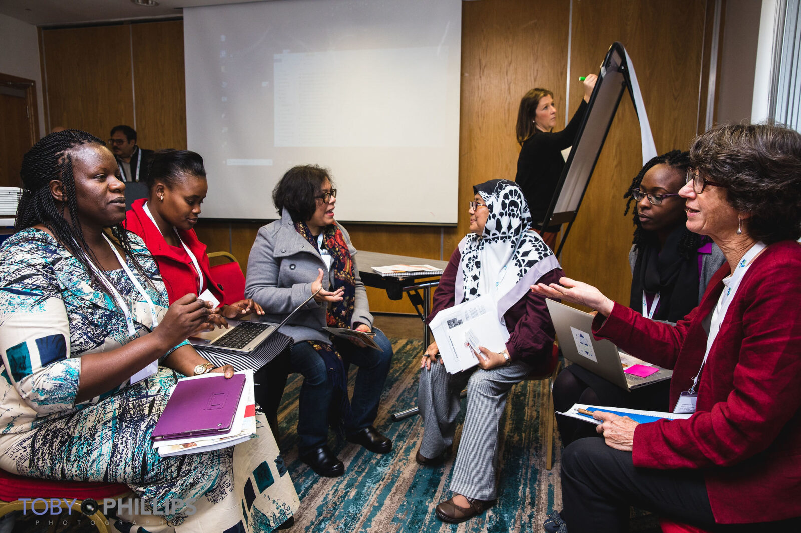 Women talking in a conference room during HSR2018