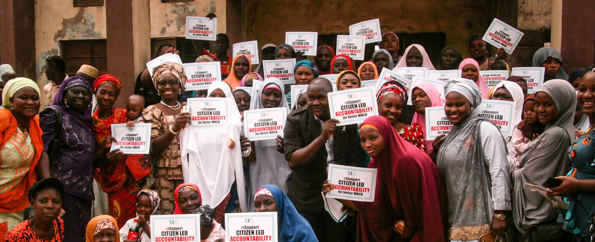 A group of women in Nigeria holding signs that say
